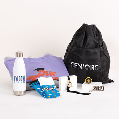 "Celebrate your Senior pride with everything you need in one bundle. This popular Grad Pack includes:   a FREE Class of 2021 Senior hoodie a bling tassel to hang or display anywhere your choice of two best-selling T-shirts, Seniors 2021 polyester mesh athletic shorts or 2021 socks of cotton, nylon and spandex an ""I'm Done"" water bottle a Seniors drawstring backpack a 2021 silvertone keyring a ""See Ya"" phone socket"