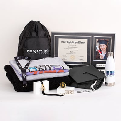 This is the best way to celebrate and show your 2021 Senior pride all year long. This unbeatable Grad Pack includes:   FREE cap & gown graduation essentials – typically includes a tassel, diploma cover and/or any additional items required for graduation (varies by school; ask your rep for details)  a bling tassel to hang or display anywhere a quality wood diploma frame for your diploma alongside a 4