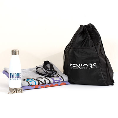 "This one–stop shop includes all of your must-have Senior celebration gear. This essential Grad Pack includes:   your choice of one best-selling T-shirt a classic preshrunk cotton Seniors 2021 T-shirt an ""I'm Done"" water bottle a Seniors drawstring backpack a 2021 silvertone key ring a ""No Limits"" lanyard"
