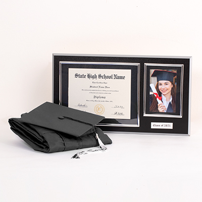 "This one-stop shop includes all of your must-have Senior celebration gear. This essential Grad Pack includes: cap & gown, graduation essentials - typically includes a tassel, diploma cover and/or any additional items required for graduation (varies by school; ask your rep for details), a quality wood diploma frame for your diploma alongside a 4"" x 6"" photo and year plaque (available for 6"" x 8"", 7"" x 9"", 8"" x 10"", or 8.5"" x 11"" diplomas), sku number A0227660"