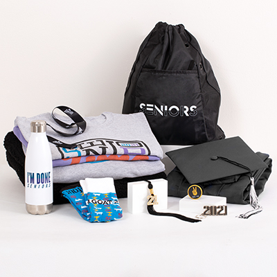 "Make this year both exciting and hassle-free with all the best 2021 Senior celebration gear arriving in one box. This incredible Grad Pack includes: a FREE Class of 2021 Senior hoodie, cap & gown, graduation essentials - typically includes a tassel, diploma cover and/or any additional items required for graduation (varies by school; ask your rep for details), a bling tassel to hang or display anywhere, your choice of one pullover or hoodie (including Sherpa-fabric options), your choice of two best-selling T-shirts, Seniors 2021 polyester mesh athletic shorts or 2021 socks of cotton, nylon and spandex, a classic preshrunk cotton Seniors 2021 T-shirt, an ""I'm Done"" water bottle, a Seniors drawstring backpack, a 2021 silvertone keyring, a ""See Ya"" phone socket, a ""No Limits"" lanyard, sku number A0227672"