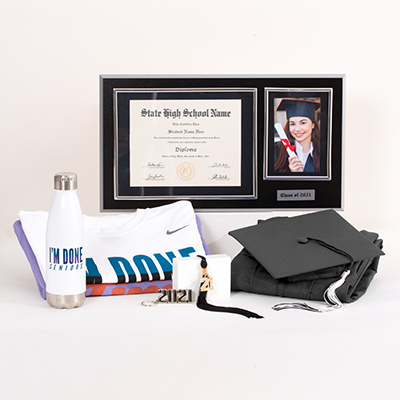 "Make sure your year is fun and memorable by having all the top 2021 Senior celebration gear. This fantastic Grad Pack includes: cap & gown, graduation essentials - typically includes a tassel, diploma cover and/or any additional items required for graduation (varies by school; ask your rep for details), a bling tassel to hang or display anywhere, a quality wood diploma frame for your diploma alongside a 4"" x 6"" photo and year plaque (available for 6"" x 8"", 7"" x 9"", 8"" x 10"", or 8.5"" x 11"" diplomas), your choice of one premium Nike Dri-Fit polyester T-shirt or Under Armour® smart fabric polyester T-shirt, your choice of one best-selling T-shirt, an ""I'm Done"" water bottle, a 2021 silvertone keyring, sku number A0227666"